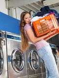 Woman Carrying Basket Of Clothes Stock Photos