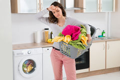 Woman Carrying Basket With Clothes Stock Photography