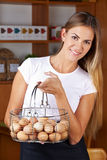 Woman carrying basket of eggs Royalty Free Stock Images