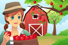 Woman carrying a basket of fruit Royalty Free Stock Photography