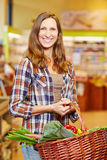 Woman carrying basket Royalty Free Stock Photo