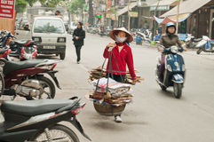 Woman Carrying Baskets on the street. Hanoi. Vietnam. Royalty Free Stock Photos