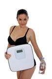 Woman carrying bathroom scales Royalty Free Stock Photo