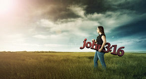 Woman carrying Bible verse. Stock Photography