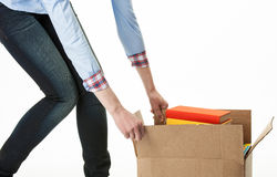Woman carrying big box with books Stock Photography