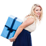 Woman carrying big gift Stock Photography