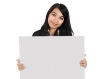 Woman carrying blank paper. Businesswoman carrying blank paper isolated on white background Stock Image