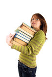 Woman carrying books Royalty Free Stock Images