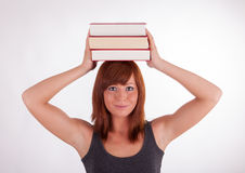 A woman is carrying books on her head Royalty Free Stock Photography