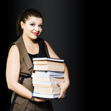Woman carrying books from library Royalty Free Stock Images