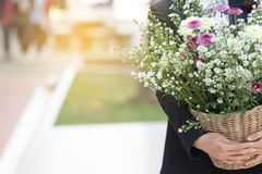 Woman carrying a bouquet of flowers. Woman carrying a bouquet of flowers stock photo