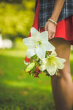 Woman carrying a bouquet of flowers Stock Photo