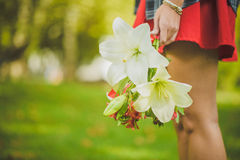 Woman carrying a bouquet of flowers Royalty Free Stock Photos