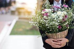 Woman carrying a bouquet of flowers. Woman carrying a bouquet of flowers royalty free stock image