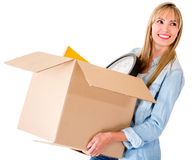 Woman carrying a box Royalty Free Stock Photos