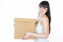 Woman is carrying the box Royalty Free Stock Image