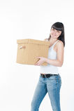 Woman is carrying the box Stock Images