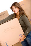 Woman carrying a box Royalty Free Stock Photo