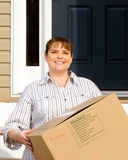 Woman carrying box on moving day Stock Image