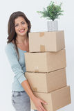 Woman carrying boxes because she is moving Stock Images