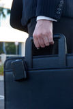 Woman carrying briefcase with pager Stock Images