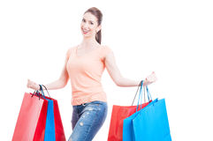 Woman carrying  bunch of gift shopping bags smiling feeling plea Stock Photo