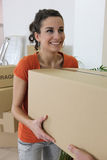 Woman carrying cardboard box Royalty Free Stock Images
