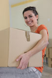 Woman carrying a cardboard box Royalty Free Stock Photo
