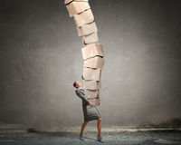 Woman carrying carton boxes . Mixed media royalty free stock images