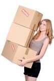 Woman carrying cartons Stock Photos