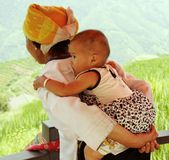 Woman carrying child in China. Woman carrying her child, Miao minority village Pingan and rice terraces of Longsheng near Guilin, Guanxi province, China, 4.08 Royalty Free Stock Photos
