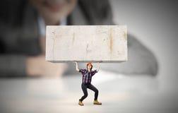 Woman carrying cube Stock Photos