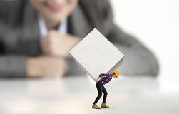 Woman carrying cube Royalty Free Stock Photo