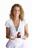 Woman carrying dessert, smiling, portrait, cut out Stock Images