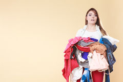 Woman carrying dirty laundry clothes. Royalty Free Stock Photography