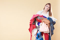 Woman carrying dirty laundry clothes. Stock Photos