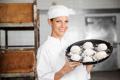 Woman Carrying Dough Balls In Baking Tray Stock Photography