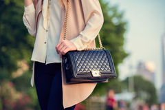 Woman carrying elegant purses bag at city park.  Royalty Free Stock Photography