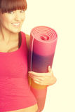Woman Carrying Exercise Mat Royalty Free Stock Image