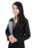 Woman carrying a folder. Businesswoman carrying a folder isolated on white background Stock Photos