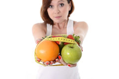 Woman carrying fruit in hands healthy lifestyle Royalty Free Stock Photo