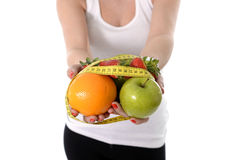 Woman carrying fruit in hands healthy lifestyle Stock Photo