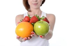 Woman carrying fruit in hands healthy lifestyle Royalty Free Stock Image