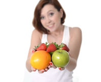 Woman carrying fruit in hands healthy lifestyle Stock Images