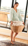Woman carrying a full laundry basket Royalty Free Stock Images