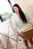 Woman carrying a full laundry basket Stock Photos