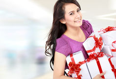 Woman carrying gift box at the shopping mall Stock Photos