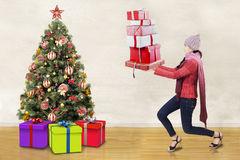 Woman carrying gift boxes Stock Photo