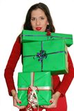 Woman carrying gifts. Focus on the gifts, woman is slightly out of focus royalty free stock photography
