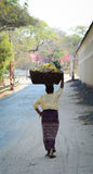 A woman carrying goods on head in Bagan, Myanmar Royalty Free Stock Photos